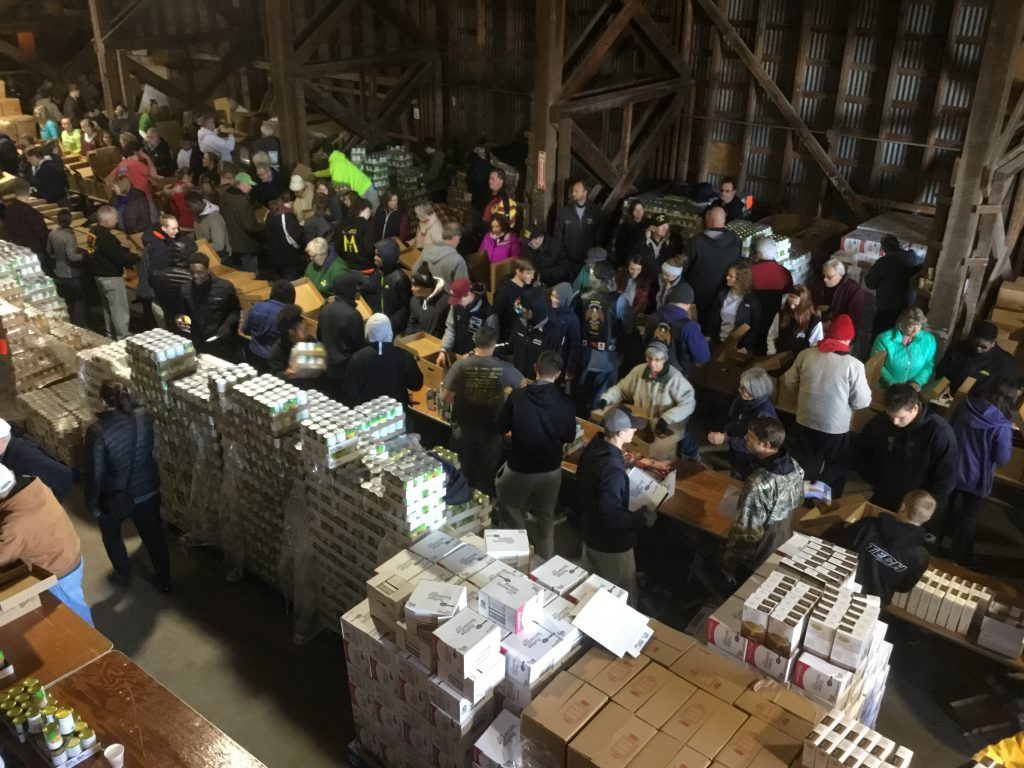 Hundreds of volunteers help pack full family meals for our annual Thanksgiving for Thousands event in Selbyville, DE.