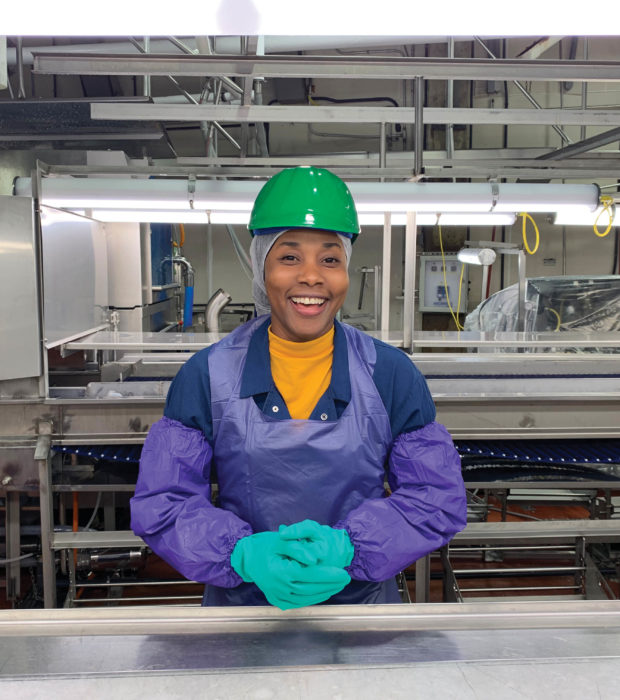 woman smiling at assembly line