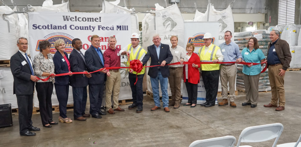 Our Executive Team and guests prepare to cut the ribbon at the grand opening of our Scotland County Feed Mill.