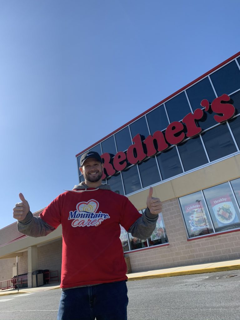 Community Relations Manager Zach Evans outside of Redner's during the annual Thanksgiving for Thousands food drive.