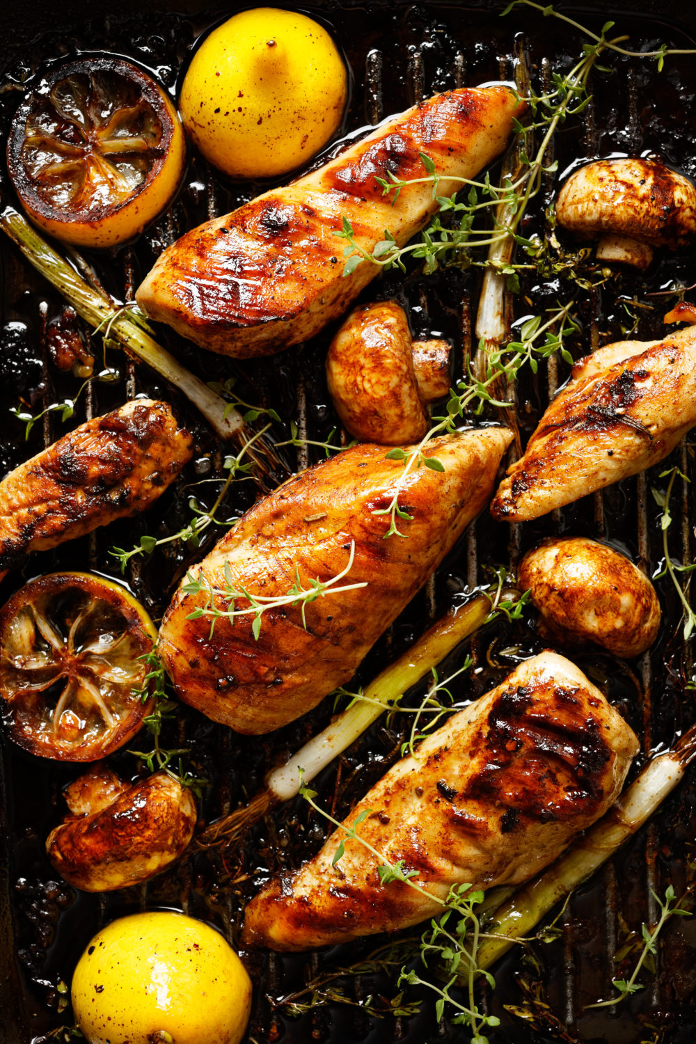 Grilled chicken breast with vegetables in a fragrant lemon marinade